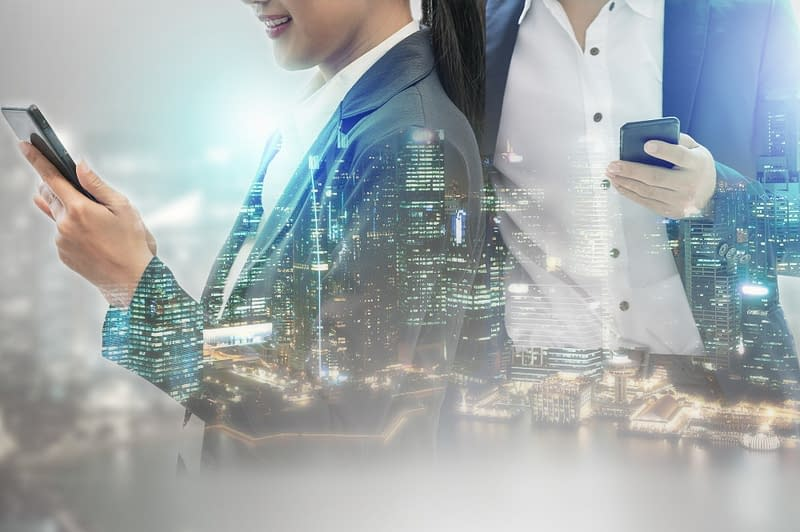 A man and a woman holding a cellphone